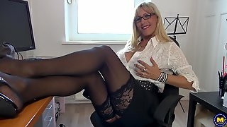 Nerdy mature blonde Lana Vegas oils herself up at the office