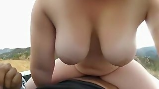 Busty girl rides her bf in the back of a truck in nature